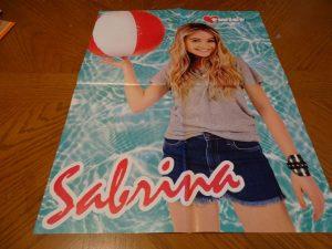 Sabrina Carpenter holding