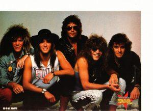 Jon Bon Jovi squatting rock band
