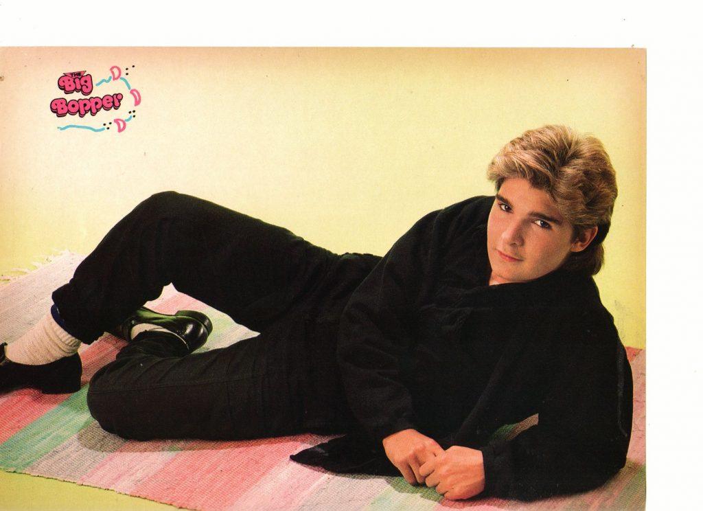 Corey Feldman black shirt laying down