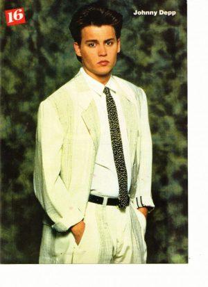Johnny Depp wearing white suit movie premiere