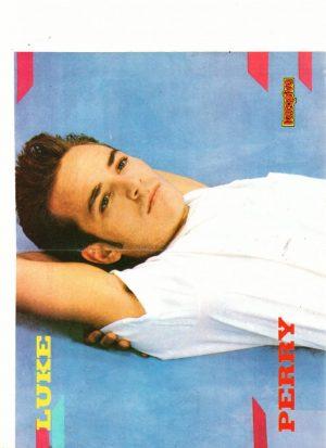 Luke Perry laying down white t-shirt 90210