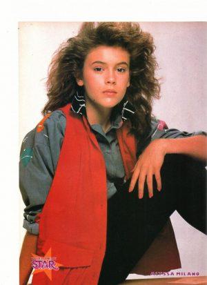 Alyssa Milano red vest sitting down